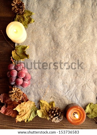 Grapes with candles.image of autumn