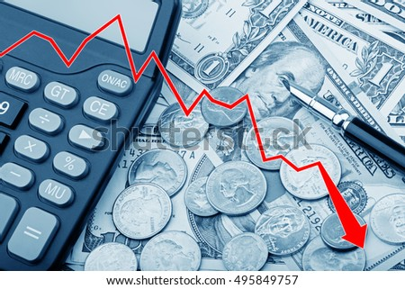 Graph showing a decline in the value of United States bank notes and coins with a calculator and pen