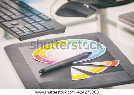 Graphics tablet and color wheel in the office