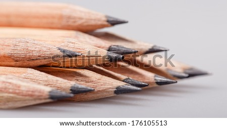 Graphite wooden pencils for sketching shot closeup background
