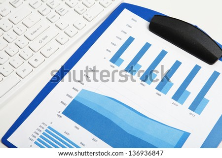 Graphs, charts, business table in the office
