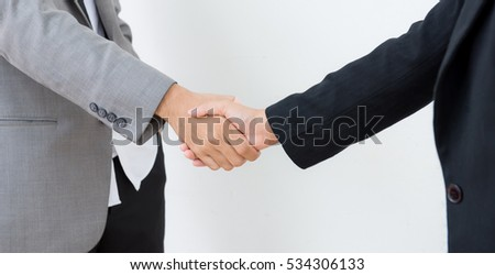 grasp hands, Partner hand between a Businessman and a Businesswoman on white background