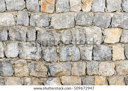 Gray and brown wall with stone masonry, background, texture