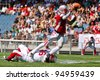 GRAZ, AUSTRIA - JULY 9: QB Christoph Gross (#8 Austria) is tackled at the Football World Championship on July 9, 2011 in Graz, Austria. Japan wins 24:6 against Austria. - stock photo