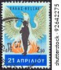 "GREECE - CIRCA 1967: A stamp printed in Greece , from the ''21st April 1967"" issue shows a renascent phoenix and a soldier which was the emblem of the military junta, circa 1967. - stock photo"