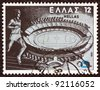 "GREECE - CIRCA 1981: A stamp printed in Greece from the ""XIII European athletics championship"" issue shows an athlete running and the Olympic stadium of Athens, circa 1981. - stock"