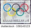 GREECE - CIRCA 1968: A stamp printed in Greece issued for 6th April, Olympic day shows Olympic Rings and globe, circa 1968. - stock photo
