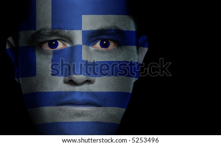 Greek flag painted/projected onto a man's face.