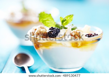 greek yogurt on blu table