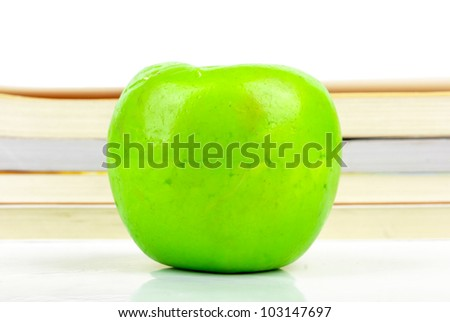 Green apple with book