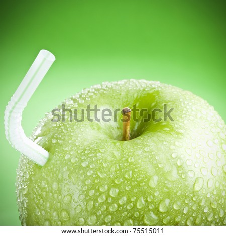 Green apple with straw, like a fruit juice !