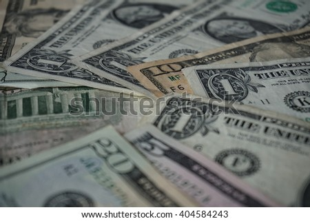 Green bank notes of the US Dollars forming the shape of circle