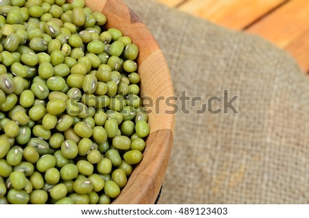 green beans mung in bucket on wooden table