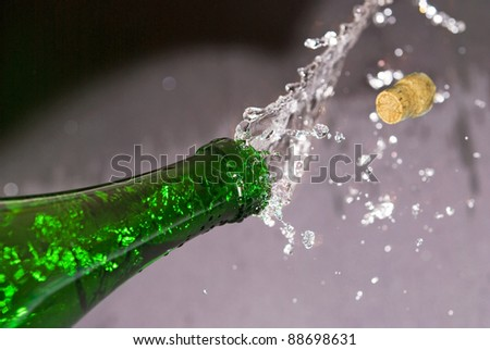 green bottle and cork flying