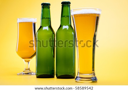 Green bottle of beer and glass