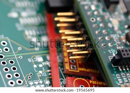 Green circuit board with components.