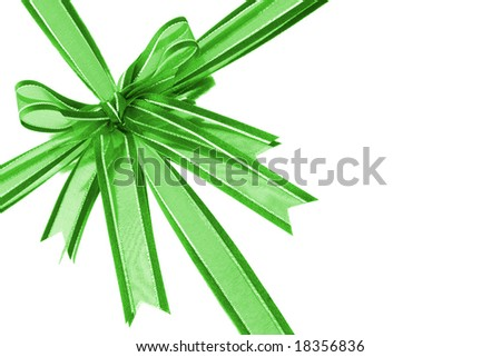 Green decorative bow ribbon on white reflective background with copy space