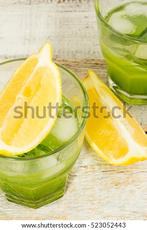 green drink with tarragon and lemon wedges