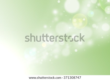 Green glitter sparkle defocused radial rays lights bokeh beautiful abstract background.