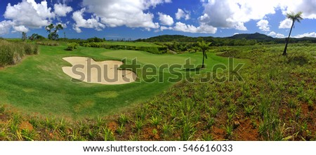 green golf course panorama sand bunker with blue sky in summer