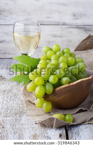 Green grape and glass of wine. Selective focus