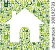 Green icons background in home shape. - stock photo