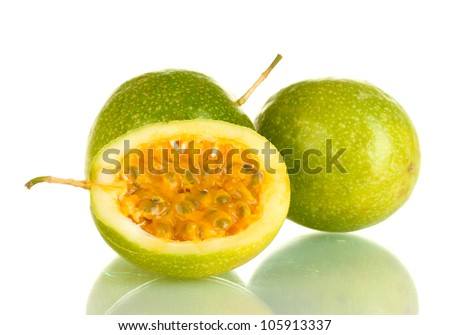 green passion fruit isolated on white background close-up