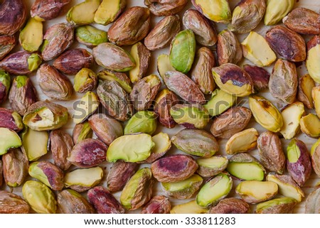 Green pistachio nuts without shell background