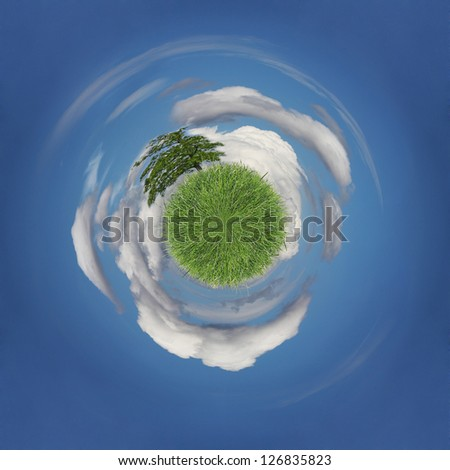 Green planet covered with grass floating in the sky area