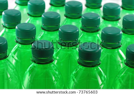 Green plastic bottles in a row