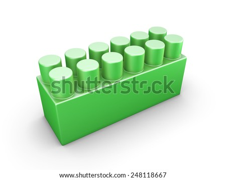 Green plastic construction element of the children designer isolated on white background.