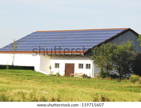 Green renewable energy with photovoltaic installations on the roof.