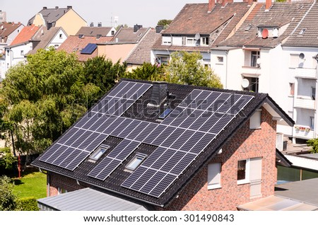 Green Renewable Energy with Photovoltaic Panels on the Roof.