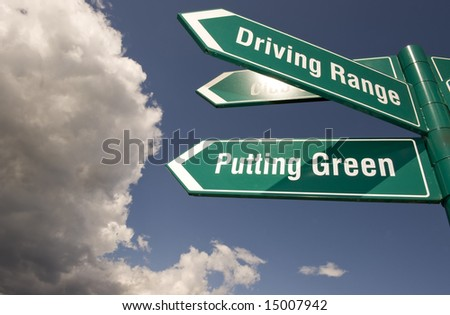 Green signs at the golf course with clouds behind