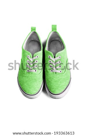 Green textile sneakers with white laces isolated over white