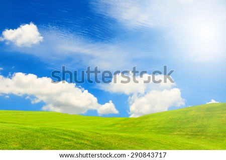 green valley hills with blue sky