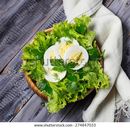 Green vegetarian salad with egg. Selective focus. Top view