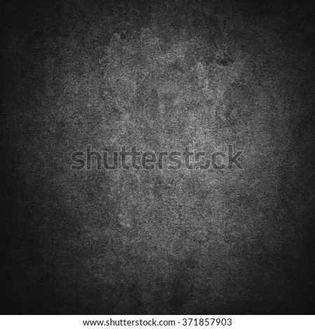 Grey or black grunge concrete solid wall background