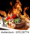 Grilled Beef Steak with flames - stock photo