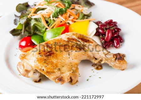 Grilled chicken steak western food style with salad vegetable