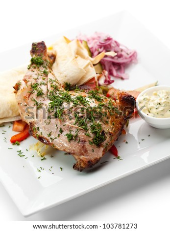 Grilled Chicken with Lavash, Vegetables and Pickled Onions. Garnished with Tartar Sauce