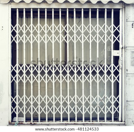 Grilled door protect any thing in house & Wrought Iron Gate Door Fence Window Stock Vector 420265591 ... pezcame.com