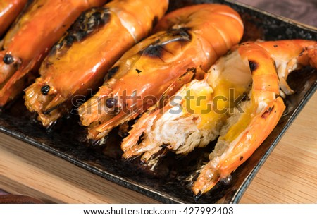 Grilled Giant River shrimp in the dish,Flame grilled large prawns on black plates, use for seafood, health and wellness related concepts