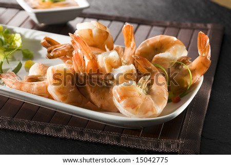grilled giant shrimps decorated on white plate with dip sauce