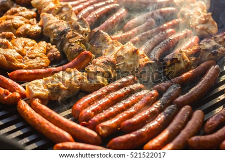 Grilled meat on the barbecue,cooked outdoor .