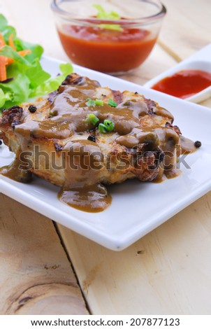 Grilled steaks, pork with pepper gravy and vegetable salad