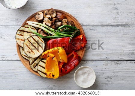 grilled vegetables mix on plate, above