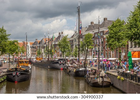 GRONINGEN, THE NETHERLANDS - JULY 26: People are walking along the Hoge Der A to see the historical sailing ships at the ZomerWelVaart festival on July 26, 2015 in Groningen