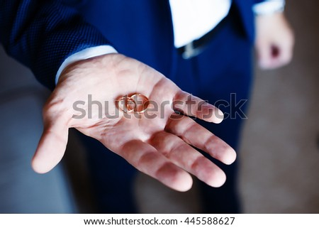 Groom Holds Wedding Rings Hands Closeup Stock Photo 445588618