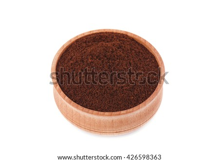 Ground coffee in a wooden bowl, isolated on white background